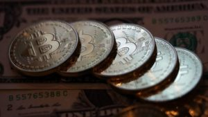 bitcoin coins and dollars